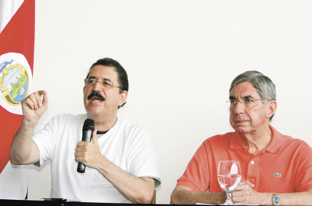 Hondura's President Manuel Zelaya, left, speaks as Costa Rica's President Oscar Arias looks on during a press conference at the Juan Santamaria International airport in San Jose, Sunday, June 28, 2009. Soldiers seized Honduras' national palace and sent Zelaya into exile in Costa Rica on Sunday, hours before a disputed constitutional referendum. Zelaya, a leftist ally of Venezuelan President Hugo Chavez, said he was victim of a coup. (AP Photo/Kent Gilbert)