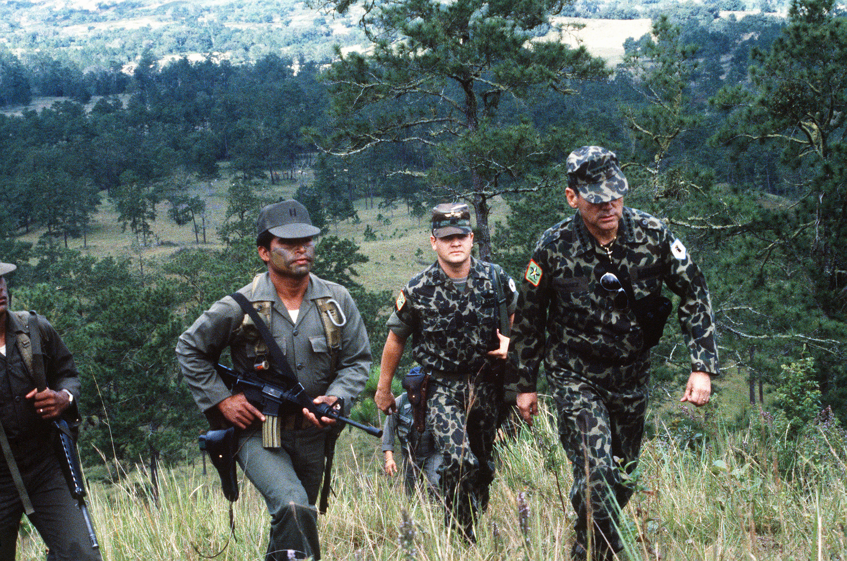 General Gustavo Adolfo Alvarez Martinez, chief of the Honduran armed forces, arrives at San Estaban Valley with his aides and bodyguards.  Martinez is in the area to observe a parachute drop by Honduran troops during Exercise AHUAS TARA (BIG PINE) II.