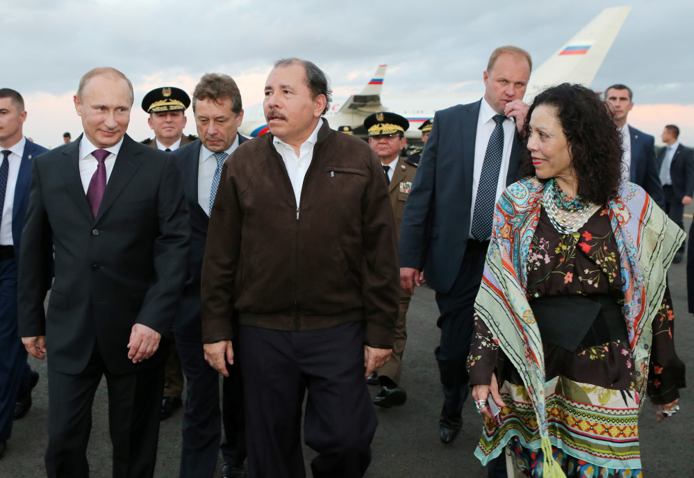 "A handout photo distributed by the Presidencia de Nicaragua shows Russian President Vladimir Putin (L) walking with the President of Nicaragua Daniel Ortega (4L) upon Putin's arrival at the Augusto C. Sandino Airport in Managua, on July 11, 2014. They spoke of their commitment to peace, the welfare of the people, fighting poverty, drug trafficking, organized crime and terrorism. Putin arrived in Nicaragua is part of his Latin American tour, to Cuba, Argentina and Brazil where he will participate in the Summit of the BRICS, which brings together economic powers such as Brazil, Russia, India, China and South Africa. Putin will attend the closing of the World Cup 2014, taking into account that Russia will host the next championship in 2018. AFP PHOTO/ Presidencia de Nicaragua / César PEREZ / HANDOUT == RESTRICTED TO EDITORIAL USE - MANDATORY CREDIT "" AFP PHOTO / PRESIDENCIA DE NICARAGUA / César PEREZ"" - NO MARKETING NO ADVERTISING CAMPAIGNS - DISTRIBUTED AS A SERVICE TO CLIENTS =="