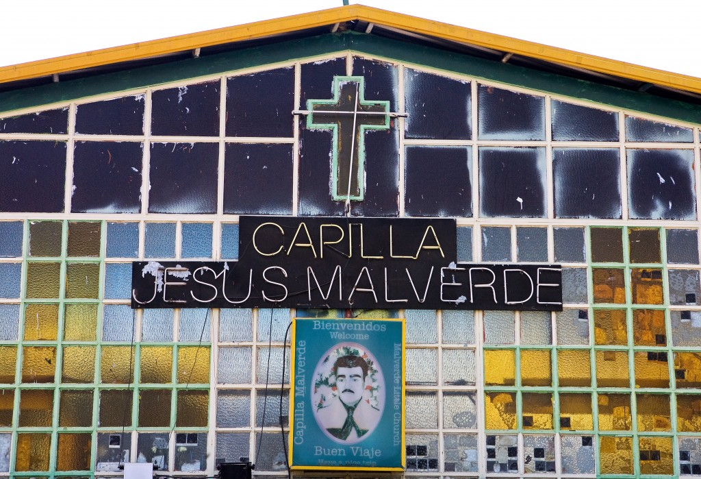 "Detail of the facade of the chapel of Saint Jesus Malverde, a bandit of the XVIII century turned into the ""saint of the drug dealers"" by the people in Culiacan, Sinaloa state, Mexico on June 2, 2008. Mexico is being whipped by a war among drug cartels disputing their place and the trafficking to the United States with unusual ferocity and sophisticated arms on June 11, 2008. Executed, beheaded, tied and tortured bodies with messages against rival bands, or threatened police and street announcements are part of the geography of violence in several states of Mexico. In the course of the year, there were at least 1,378 deaths, 47% more than in the same period in 2007.  AFP PHOTO/LUIS ACOSTA"