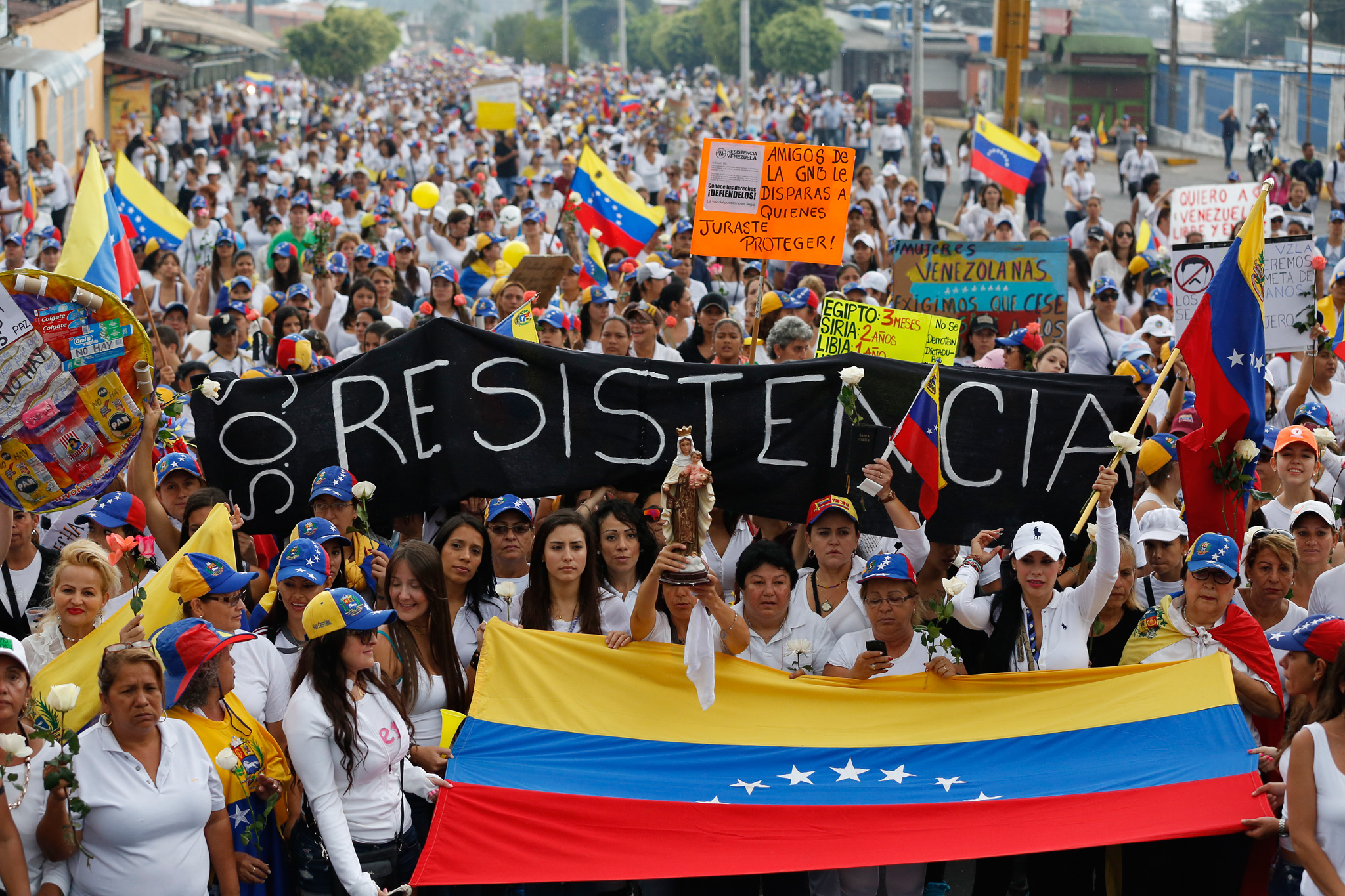 "Opposition demonstrators take part in a women's rally against Nicolas Maduro's government in San Cristobal, about 410 miles (660 km) southwest of Caracas, February 26, 2014. Pope Francis called on Wednesday for an end to violence in Venezuela that has killed at least 13 people and urged politicians to take the lead in calming the nation's worst unrest for a decade. The banner reads: ""Resistance"". REUTERS/Carlos Garcia Rawlins (VENEZUELA - Tags: POLITICS CIVIL UNREST) - RTR3FR40"