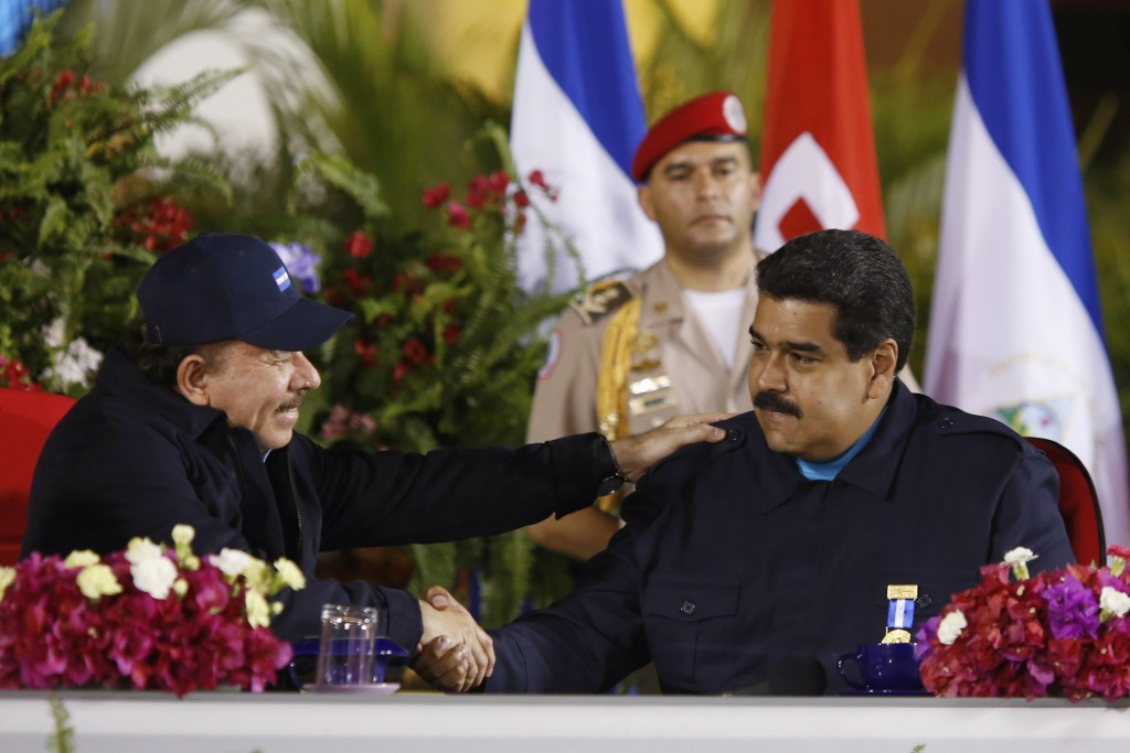 Venezuela's President Nicolas Maduro (R) and Nicaragua's President Daniel Ortega shake hands during a ceremony with Sandinista supporters in Managua in this March 13, 2015 picture provided by Miraflores Palace. Hundreds of Sandinistas marched in the avenues in support of Maduro's government and against the new sanctions imposed by the U.S. on a group of officials in Venezuela. Picture taken March 13, 2015. REUTERS/Miraflores Palace/Handout via Reuters (NICARAGUA - Tags: POLITICS) ATTENTION EDITORS - THIS PICTURE WAS PROVIDED BY A THIRD PARTY. REUTERS IS UNABLE TO INDEPENDENTLY VERIFY THE AUTHENTICITY, CONTENT, LOCATION OR DATE OF THIS IMAGE. THIS PICTURE IS DISTRIBUTED EXACTLY AS RECEIVED BY REUTERS, AS A SERVICE TO CLIENTS. FOR EDITORIAL USE ONLY. NOT FOR SALE FOR MARKETING OR ADVERTISING CAMPAIGNS