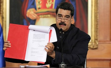 Venezuela's President Nicolas Maduro holds a document as he speaks during a ceremony at Miraflores Palace in Caracas, Venezuela May 1, 2017. Miraflores Palace/Handout via REUTERS ATTENTION EDITORS - THIS PICTURE WAS PROVIDED BY A THIRD PARTY. EDITORIAL USE ONLY.