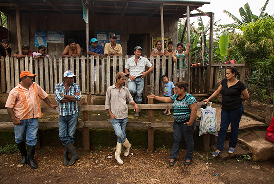 """Francisca """"Chica"""" Ramirez, an anti canal leader among campesinos in El Roble, Rio San Juan, gathers local campesinos together to inspire their attendance at the upcoming protest in El Tule. Nicaragua, June 10, 2016"""