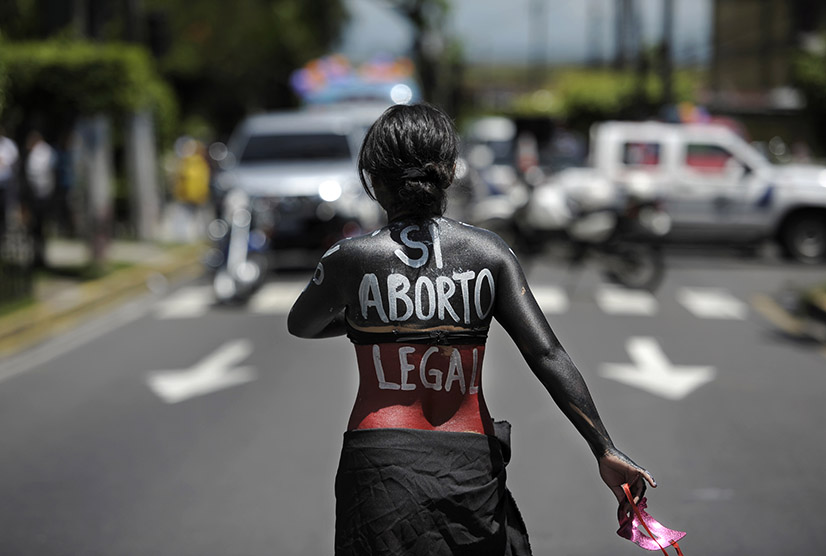 A woman participates in a march on the International Day of Action for the Decriminalization of Abortion, on September 28, 2012 in San Salvador. Salvadorean women marched to ask the government to legalize abortion as a right for women. AFP PHOTO/Jose CABEZAS