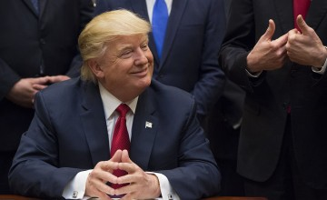 U.S. President Donald Trump smiles after signing bill S. 544, the Veterans Choice Program Extension and Improvement Act, in the Roosevelt Room of the White House in Washington, D.C., U.S., on Wednesday, April 19, 2017 The bill extends a program allowing eligible veterans to seek medical care from private health-care providers. Photographer: Molly Riley/Pool via Bloomberg