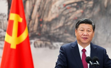 BEIJING, CHINA - OCTOBER 25:  Chinese President Xi Jinping speaks at the podium during the unveiling of the Communist Party's new Politburo Standing Committee at the Great Hall of the People on October 25, 2017 in Beijing, China. China's ruling Communist Party today revealed the new Politburo Standing Committee after its 19th congress.  (Photo by Lintao Zhang/Getty Images)