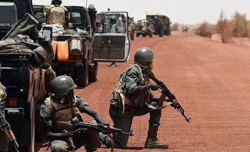 "Soldiers of the Malian Army Forces secure the pist between Goundam and Timbuktu, northern Mali, on June 2, 2015, during the joint operation ""La Madine 3"", part of the Operation Barkhane, an anti-terrorist operation in the Sahel. The head of Mali's main Tuareg-led rebel groups said on June 5, 2015, his movement will sign a final peace deal on June 20 to end the conflict in the west African nation. AFP PHOTO / PHILIPPE DESMAZES        (Photo credit should read PHILIPPE DESMAZES/AFP/Getty Images)"