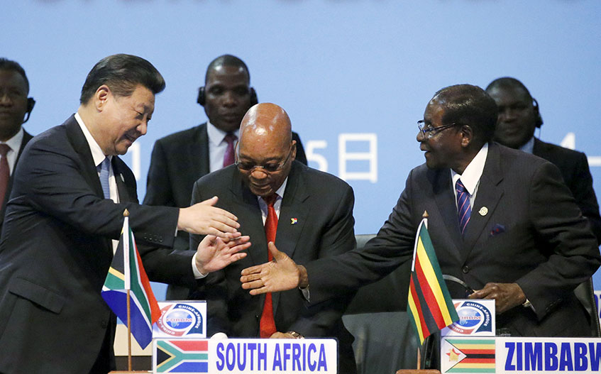 China's President Xi Jinping (L) shakes hands with Zimbabwe's President (R) Robert Mugabe while South Africa's President Jacob Zuma looks on during a Forum on China-Africa Cooperation in Sandton, Johannesburg, December 4, 2015. REUTERS/Siphiwe Sibeko - RTX1X5GJ