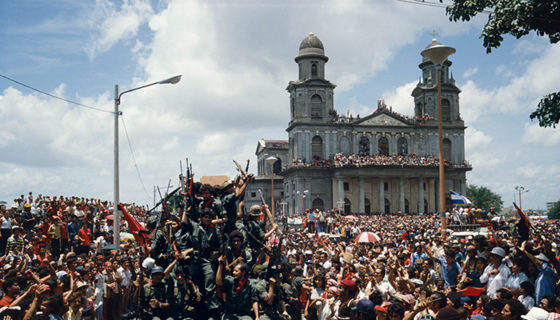 NICARAGUA. Managua. July 20, 1979. Entering the central plaza in Managua to celebrate victory.