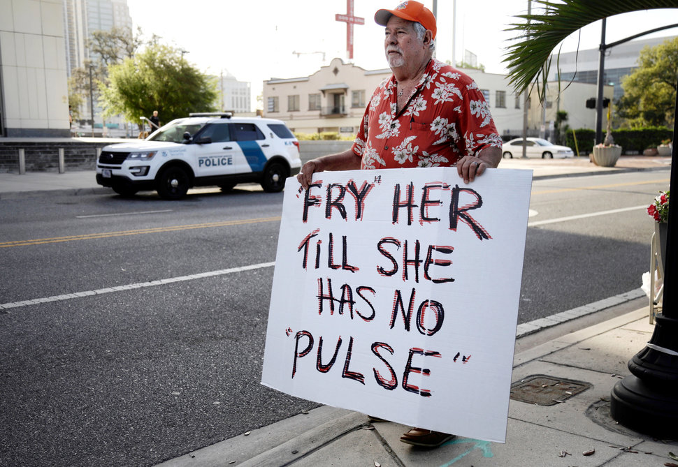 Bob Kunst protests against the widow of the Pulse nightclub shooter Noor Salman, who faces charges of aiding her husband in killing 49 people in 2016, outside the federal court house in Orlando, Florida, U.S. March 1, 2018. REUTERS/Joey Roulette